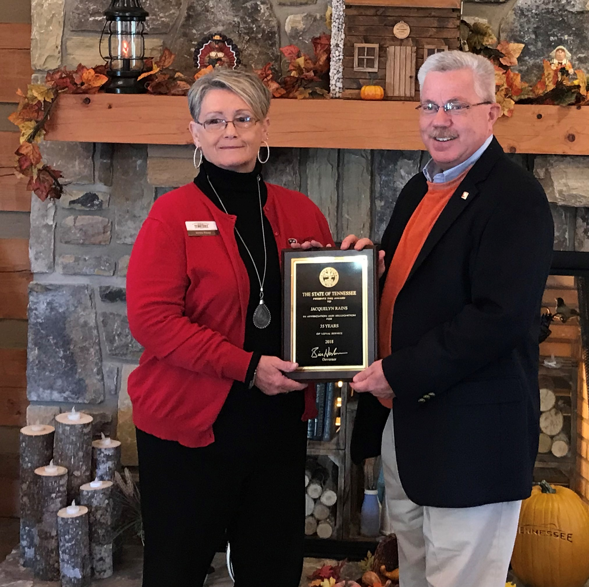 Commissioner Triplett presented Jackie Rain with a 35-year service plaque.