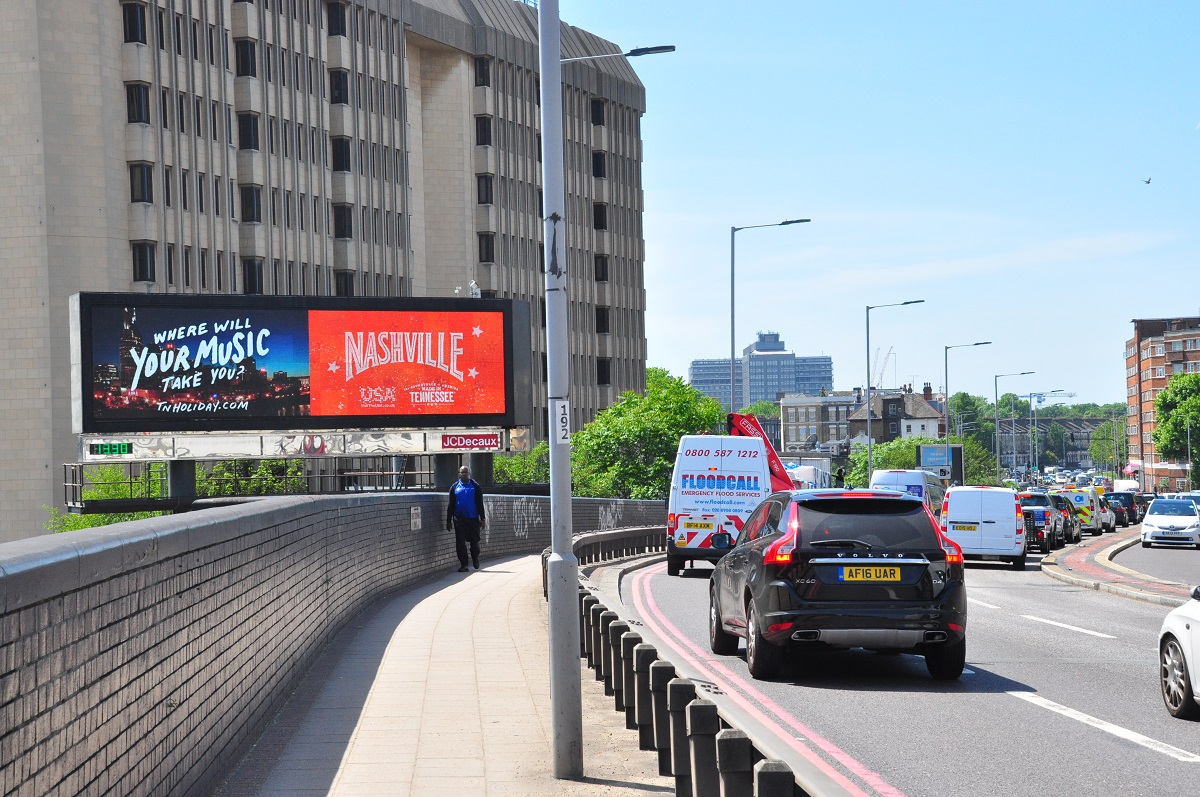 The UK activation includes billboards that encourage British travelers to discover experiences across Tennessee.