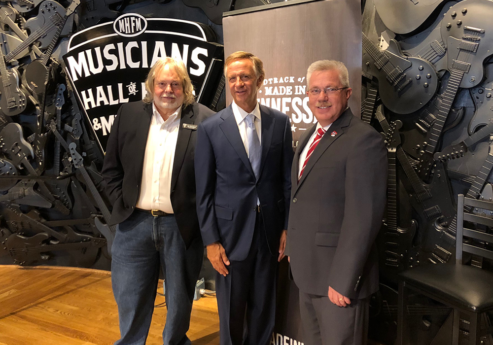 Left to right: Joe Chambers, director of the Musician's Hall of Fame and Museum; Gov. Bill Haslam; Commissioner Kevin Triplett, Tennessee Department of Tourist Development following the record-setting announcement of economic impact at Musician's Hall of Fame and Museum in Nashville.