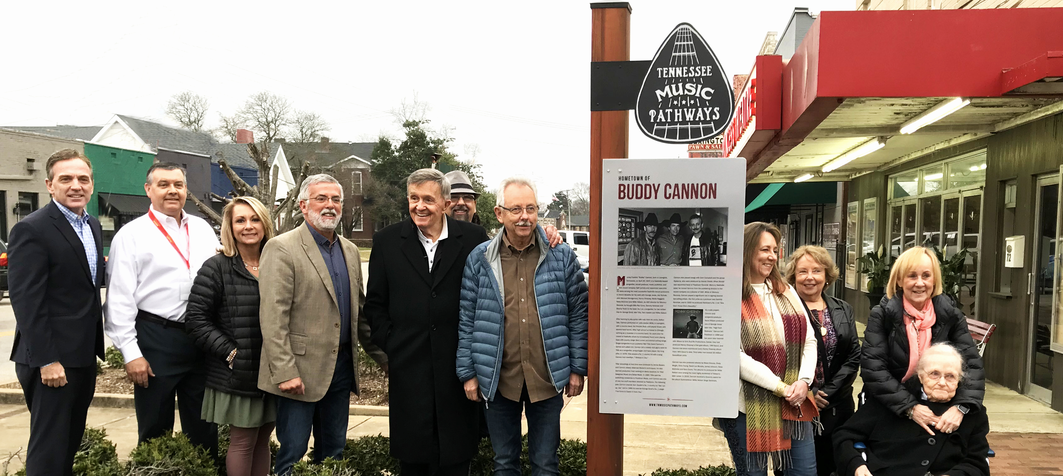 Buddy Cannon, first from left of TN Music Pathways sign, was honored in Lexington for his accomplishments as a Grammy Award-winning songwriter.